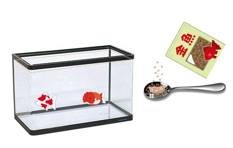 スプーンにすくった金魚のエサ